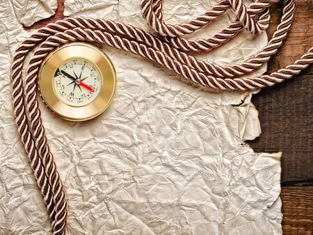 old paper and cooper compass with cord photo