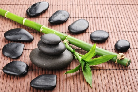 bamboo mat: spa frame with zen stones and  bamboo Stock Photo