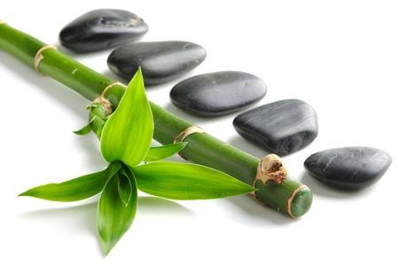 black pebbles: spa frame with zen stones and  bamboo Stock Photo