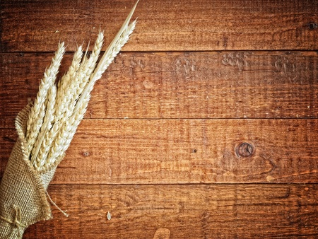 wheat in the mug on the wooden background