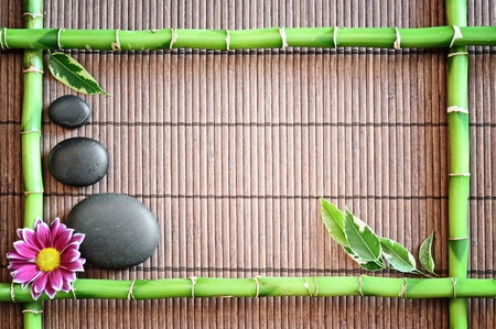 bamboo mat: spa frame with zen stones and  flower