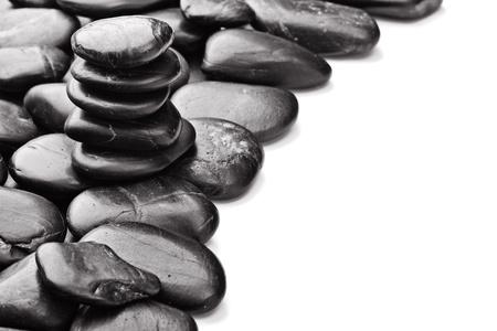 black backgound: black basalt stones on the white backgound