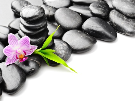 stack stones: spa concept with zen stones and flower Stock Photo