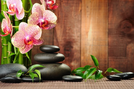 spa still life: zen basalt stones and orchid on the wood Stock Photo