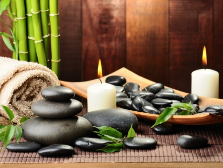 black pebbles: zen basalt stones and bamboo on the wood