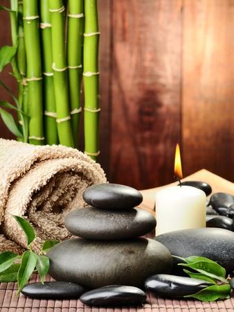 massage symbol: zen basalt stones and bamboo on the wood
