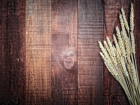 grange: golden wheat on the old wooden background