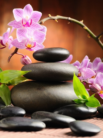 stone heap: zen basalt stones and orchid on the wood Stock Photo