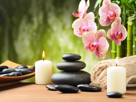zen candles: zen basalt stones and bamboo on the wood
