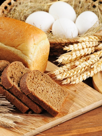 life loaf: sliced bread and wheat on the wooden table