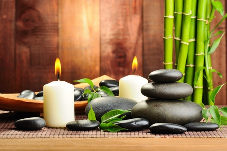 massage symbol: zen basalt stones and bamboo on the wood