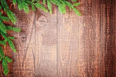 feliz: christmas tree on the old wooden background Stock Photo