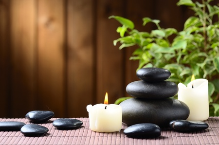 wooden aromatherapy: zen basalt stones and bamboo on the wood