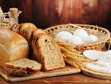 bread and wheat on the wooden background Stock Photo - 11985971