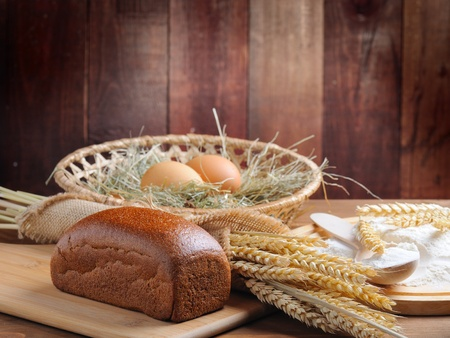 bread and wheat on the wooden background Stock Photo - 11985903