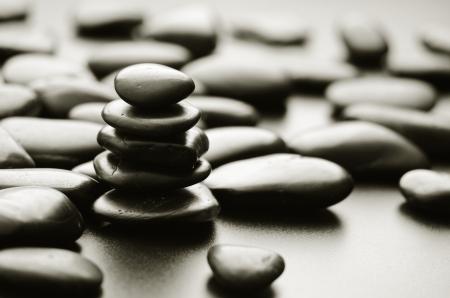 life balance: zen basalt stones on the black