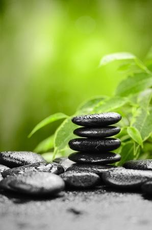 zen basalt stones and bamboo on the wood photo