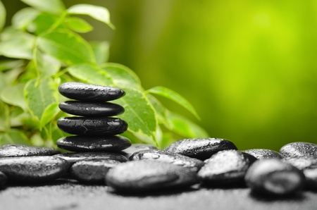 zen basalt stones and bamboo on the wood Stock Photo - 12453717