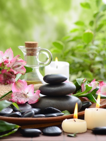 aromatherapy: zen basalt stones and bamboo on the wood