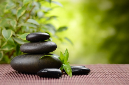 stone therapy: zen basalt stones and bamboo on the wood