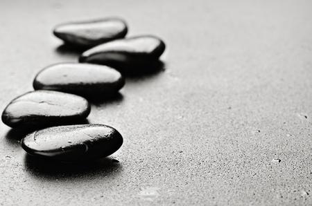 massage symbol: zen basalt stones  with dew