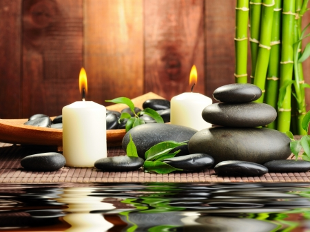 spa candles: zen basalt stones and bamboo on the wood