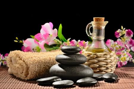 zen basalt stones and massage oil on the black photo