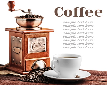 coffee beans and old coffee mill photo