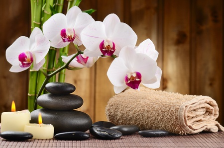 natural therapy: zen basalt stones and bamboo on the wood