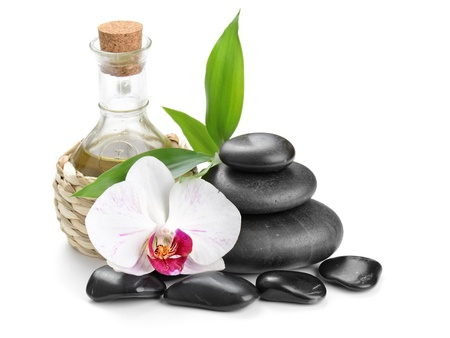 aromatherapy oils: zen basalt stones and sea salt on the white