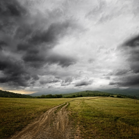 dirt road at the summer dramatic day photo