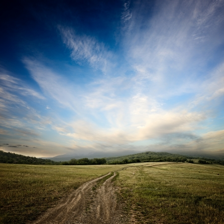 dramatic sky: dirt road at the summer dramatic day