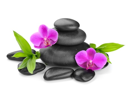 zen stones: zen basalt stones and orchid isolated on white Stock Photo