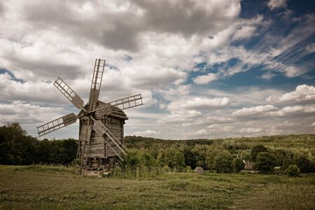 old windmill blue sky and white clouds photo