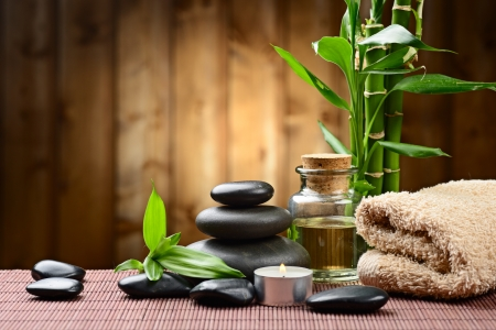 aromatherapy oils: zen basalt stones and bamboo on the wood