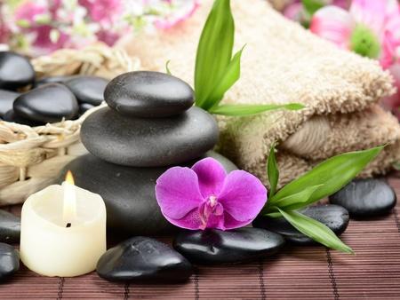 massage symbol: zen basalt stones and orchid Stock Photo
