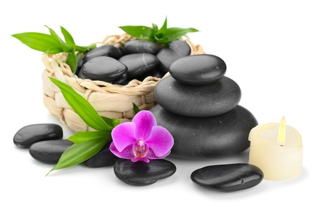 zen basalt stones and orchid isolated on white photo
