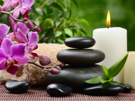 alternative therapies: zen basalt stones and bamboo on the wood