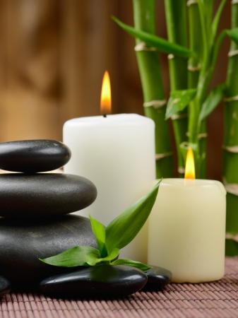 zen basalt stones and candle on the wood photo