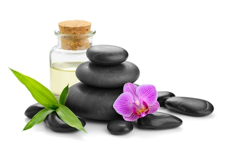 oil massage: zen basalt stones and orchid Stock Photo