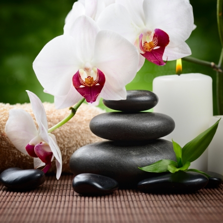 zen basalt stones and bamboo on the wood Stock Photo - 15935911