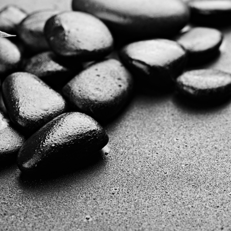zen basalt stones on the black photo