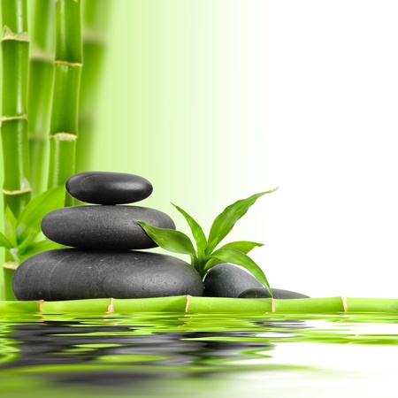 massage symbol: zen basalt stones and bamboo