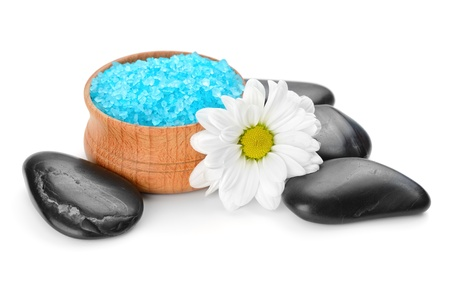 spa still life: zen stones and flowers isolated on white