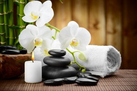 alternative wellness: zen basalt stones and orchid on the wood Stock Photo