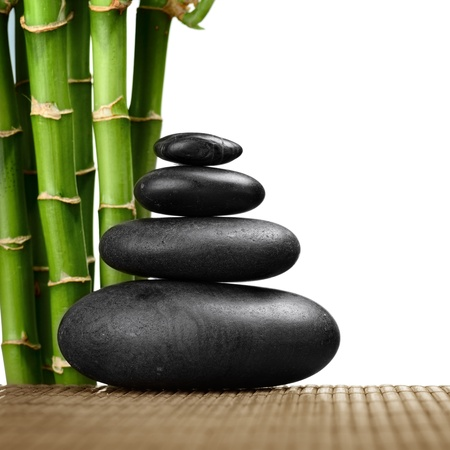 zen basalt stones and bamboo on the white Stock Photo