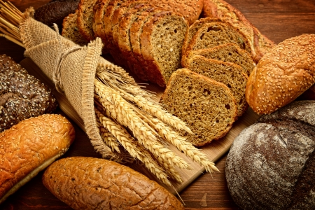 grain: fresh bread  and wheat on the wooden