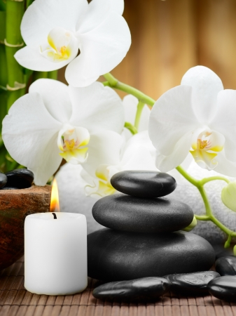 zen basalt stones and orchid on the wood Stock Photo
