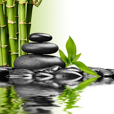 massage symbol: zen basalt stones and bamboo on the white Stock Photo