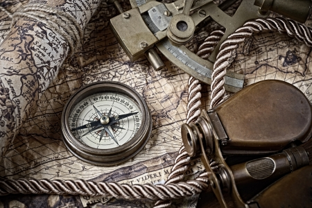 antique binoculars: vintage  still life with compass,sextant and old map Stock Photo